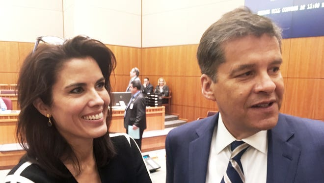 New Mexico Sen. Joseph Cervantes, D-Las Cruces, right, greets other New Mexico Senate members with this wife, Jennifer Cervantes, left, as the New Mexico Legislative session began Tuesday, Jan. 16, 2018, in Santa Fe, N.M. Criminal justice initiatives and state spending increases for public education, law enforcement, Medicaid and economic development are at the top of the agenda as the New Mexico Legislature convened for a 30-day session.