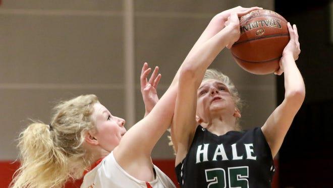 West Allis Hale's Emily Capper's drive to the basket is blocked by Divine Savior Holy Angel's Ellie Cesarz at DSHA on Jan. 16