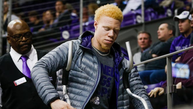 TCU Horned Frogs guard Jaylen Fisher leaves the arena on crutches late in the second half of a game against the Iowa State Cyclones at Ed and Rae Schollmaier Arena.