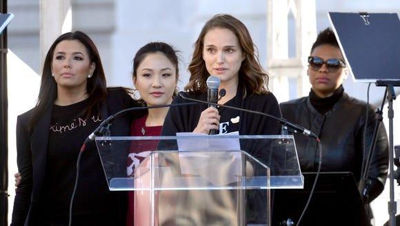 Natalie Portman, center, speaks onstage surrounded