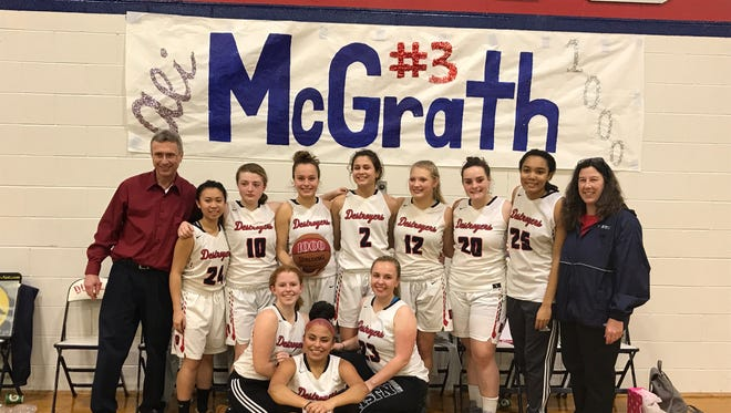Dunellen's Ali McGrath (fourth from left) scored her 1,000th career point against Highland Park on Wednesday night.