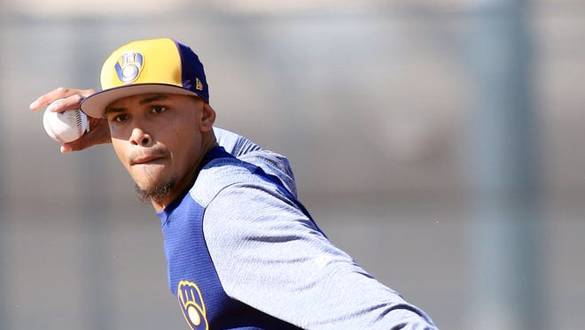 Milwaukee Brewers infielder Orlando Arcia looks to first base after fielding a grounder during spring training drills on Wednesday.