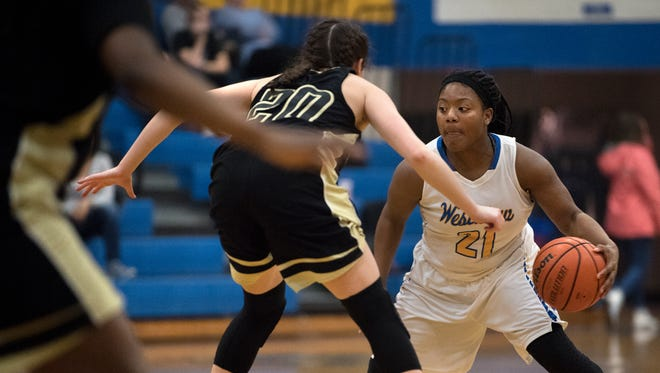 Westview's Tasia Jones dribbles the ball past Dyersburg defenders Wednesday.