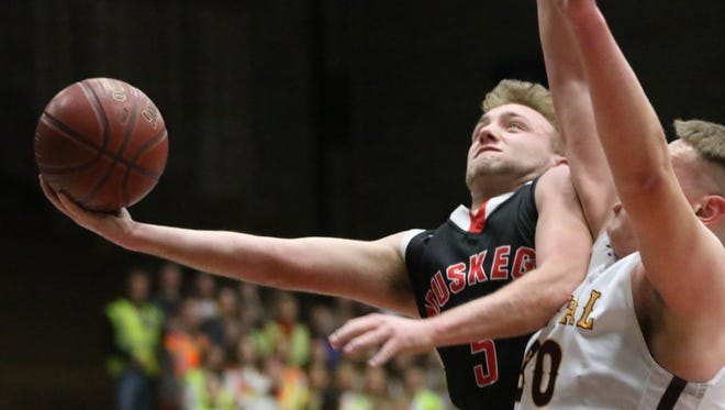 Muskego's Wesley Kwapick fires for two points against West Allis Central's Jacob Fierst in WIAA Division 1 regional play at Central on March 2.