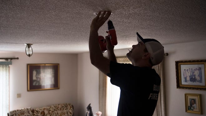 Bolivar firefighter Cody Mills installs a free smoke detector in a Bolivar home Saturday, March 17, 2018, during the ÒGet Alarmed, TennesseeÓ smoke alarm installation event. The Tennessee State Fire MarshalÕs Office (SFMO), the Bolivar Fire Department, and the American Red Cross of Mid-West Tennessee installed free smoke alarms in homes throughout Bolivar.