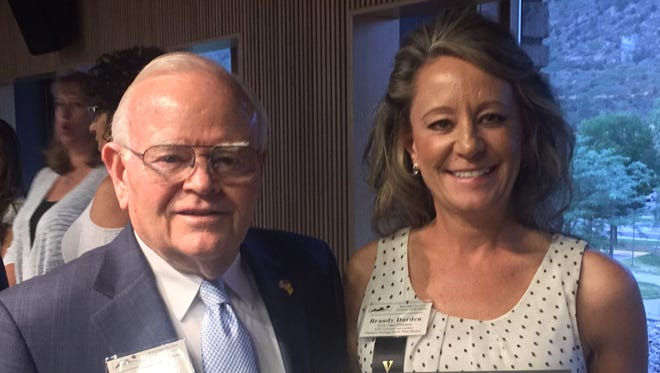 Jerry Walker, president and CEO of  Independent Community Bankers Association of New Mexico and emeritus board member for the Western States School of Banking (WSSB), presents the award to Brandy Darden on behalf of the association and WSSB.