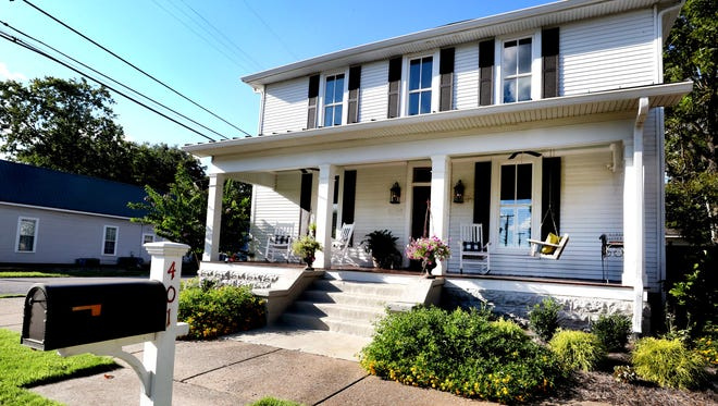 "Rick and Amy Cottle will open their newly renovated home at 401 E. Lytle St. on Sept. 18 for ""An Evening on Lytle"" to benefit the Main Street Murfreesboro revitalization initiative."