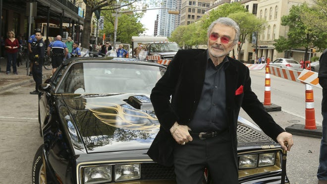 "Burt Reynolds, sitting on a 1977 Pontiac Trans-Am at the 2016 premiere of ""The Bandit"" at the South by Southwest Film Festival in Austin, Texas, said he used a cane primarily for style."