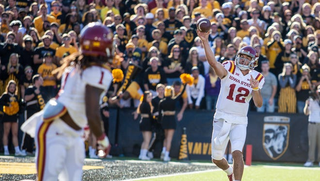 Iowa State's Sam Richardson (12) tosses a pass to Jarvis West (1) during the in-state rivalry Cy-Hawk Trophy game at Kinnick Stadium in Iowa City on Saturday, September 13, 2014. The Cyclones won 20-17 on a late field goal in the fourth quarter.