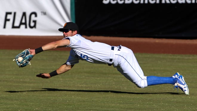 Surprise Saguaros' Bubba Starling makes a diving catch in the seventh inning of the Arizona Fall League championship game on Saturday, Nov. 21, 2015 at Scottsdale Stadium in Scottsdale. Scottsdale won the game, 6-4.