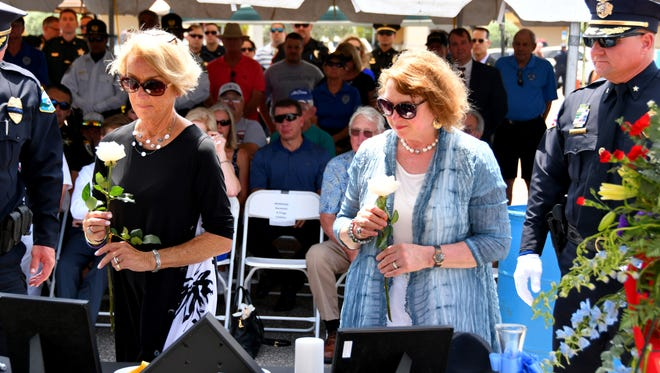 On Wednesday afternoon a memorial service  was held for Satellite Police officers Sgt. Edward Hartmann and Officer Philip Flagg, who who killed by a drunk driver 25 years ago on May 31st. Sally Flagg, mother of Officer Philip Flagg and Donna Davenport, sister of Sgt. Ed Hartmann, put flowers by the photos of the officers.