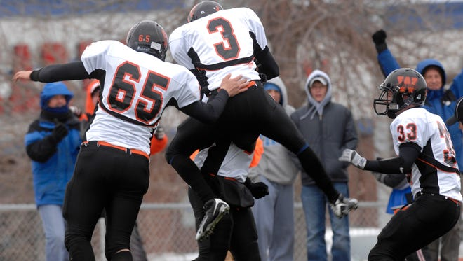 Washington players celebrate a touchdown during their 2008 semifinal win over O'Gorman at McEneaney Field.