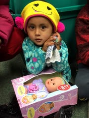 Saint's Place provides a toy to a refugee child whose family settled in the area.