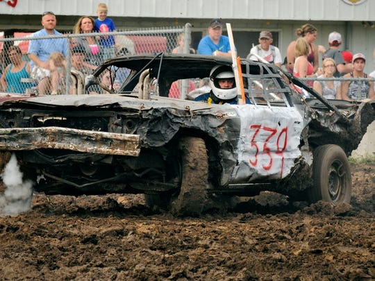 Andy Hanson, Clearwater, aims for the next car to hit with his 1976 Chevrolet Impala as he competes in the demolition derby at a previous Sherburne County Fair in Elk River in a Times file photo.