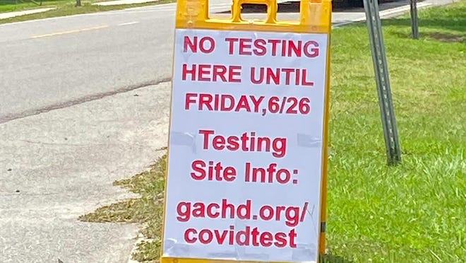 A sign seen at the Coastal Health District's fixed COVID-19 testing site at 7221 Sallie Mood Drive, pictured on June 23.