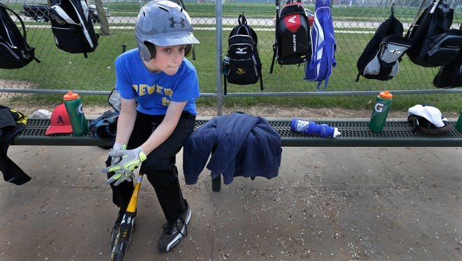 Nolan Dunnum waits for his turn to bat during practice Wednesday at Lions Park in Appleton. Nolan plays for Play It Again Sports in Appleton Little League.