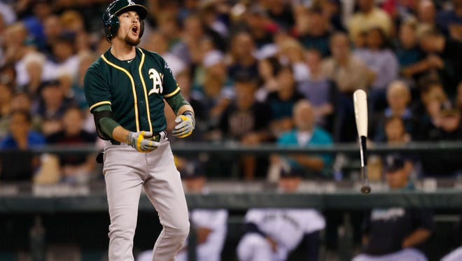 Oakland Athletics' Jed Lowrie reacts after he was called out of strikes to Seattle Mariners' Felix Hernandez during the seventh inning of a baseball game on Saturday, Sept. 13, 2014, in Seattle.