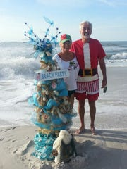 Ten years ago, Linda and James Melton started bringing a Christmas tree to Vanderbilt Beach on Christmas Day. This was the tree in 2014. Now it's become an annual tradition.
