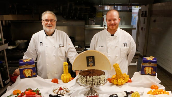 Vincenzo's chef Agostino Gabriele, left and Jay Bellucci, sous chef and kitchen manager, with some of Vincenzo's dishes.