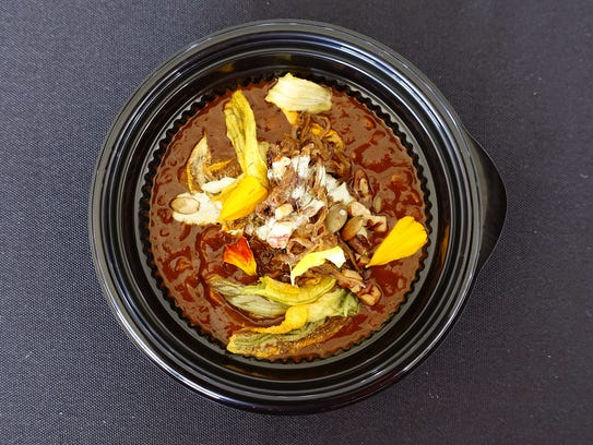 Mole de calabaza with braised lamb, red lentils, pecan and pepita gremolata and sage crema from Talavera at the 2017 azcentral.com Food & Wine Experience.