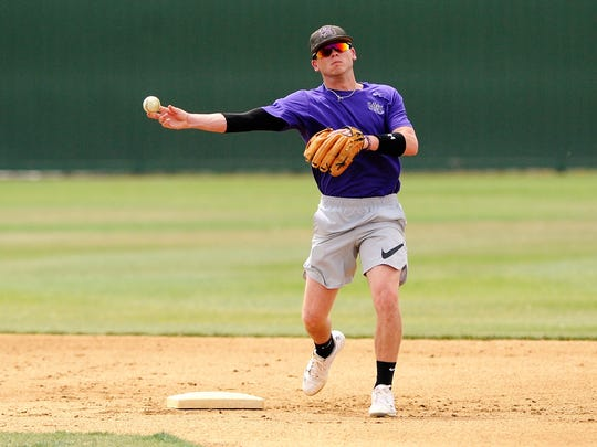 Hardin-Simmons senior shortstop Taylor Cooling throws to first after coming across the second base bag during the Cowboys' practice on Wednesday, May 2, 2018. Earlier this season Cooling broke the HSU school record for doubles in a career and now has 56 entering the American Southwest Conference tournament on Friday in Alpine.