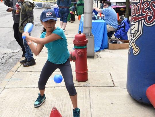 Crystal Cruz, 11, of the Town of Poughkeepsie tries