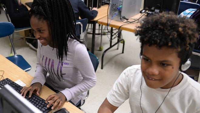 Seventh-grader Armonie Crusoe, left, and sixth-grader Ivrianna Woods code on Tuesday, Nov. 29, 2016, at Wexford Montessori Academy in Lansing. 2020 Girls is an after-school program to inspire a love of technology among girls in fourth through eighth grades.
