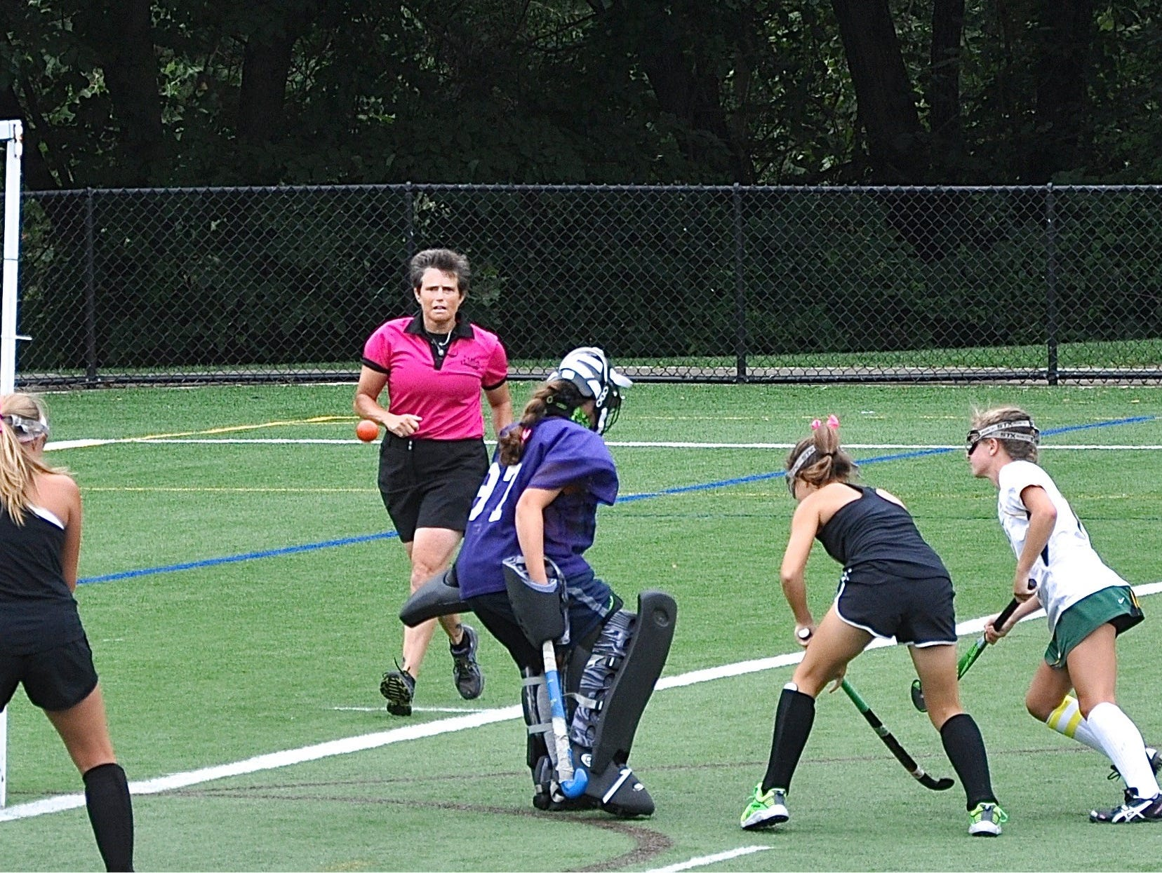 Cali Cortese (r) scores winning goal for Lakeland in benefit scrimmage game..
