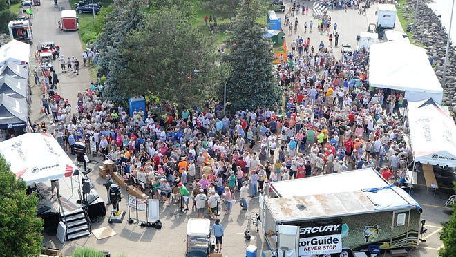 Fisherman and spectators gather at Lakeside Park Sunday afternoon, where fish are being weighed for the Walleye Weekend, Mercury Marine fishing tournament. Sunday June 14, 2015