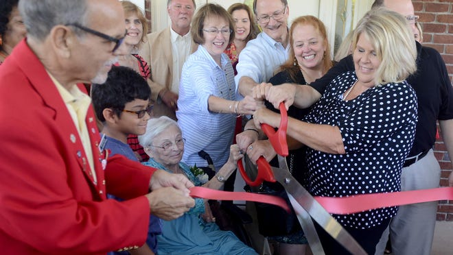 The Exchange Club-Carl Perkins Center for the Prevention of Child Abuse held a ribbon cutting and dedication ceremony, Monday. The building has been renamed in honor of the Taber-Carter family.