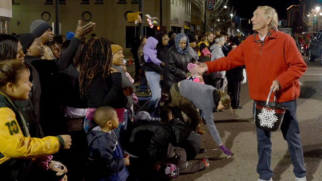 Jackson City Mayor Jerry Gist passes out candy at the 2015 City of Jackson Christamas Parade on Monday.