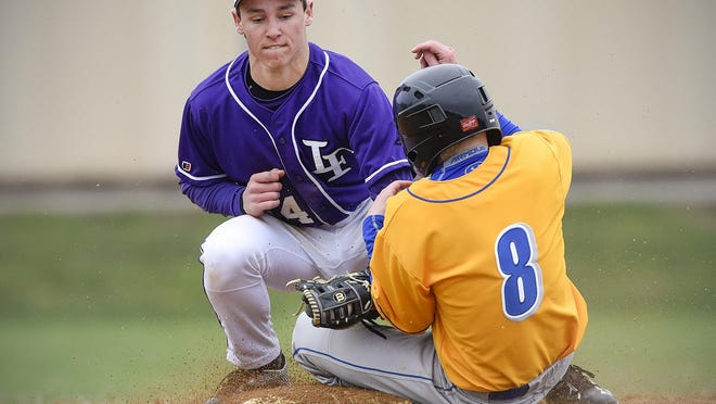 St. Cloud Cathedral's Sam Nelson, 8, slides safely under the tag of Little Falls' Austin Weisz stealing second base during the fourth inning Thursday at Little Falls High School.