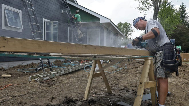 Scotty Freeman of Augusta Ga., helps build a home in Reynoldsburg for a veteran who lost both of his legs while serving in Iraq. Reynoldsburg was the nation's second-hottest housing market in the nation between April and June, according to Realtor.com.