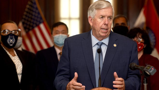 Gov. Mike Parson talks to the media following a meeting with officials from the University of Missouri, University of Missouri-St. Louis, University of Missouri Science and Technology at Rolla and Lincoln University Thursday at the capitol.