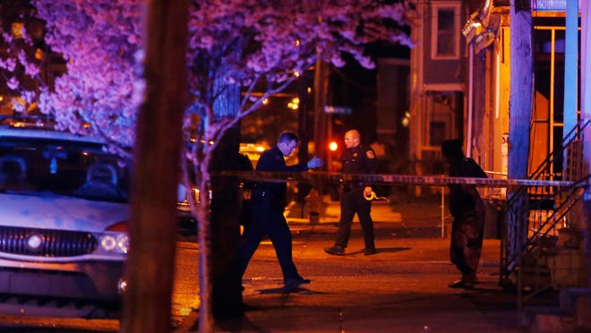 Wilmington police investigate at the scene of a shooting at W. 27th and Moore streets, reported at 9:45 p.m. Tuesday.