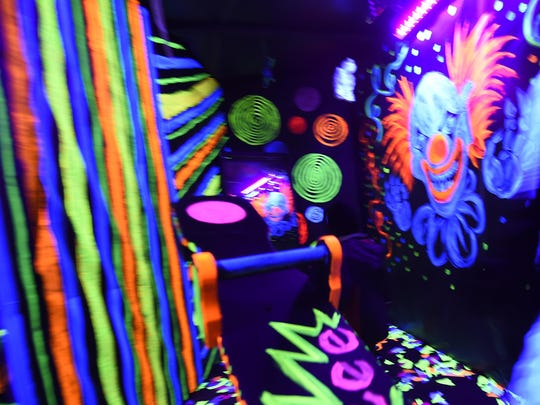 """One of several """"spook rooms"""" inside the Haunted Mansion includes a garishly painted """"black light' room."""