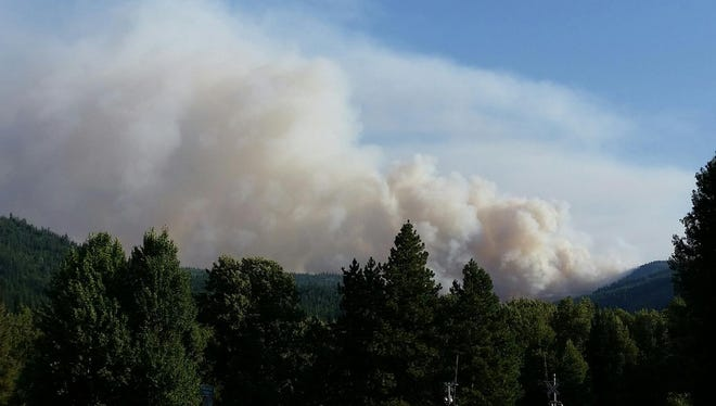 Photo showing smoke column from a fire in the Chewuikum Creek area.