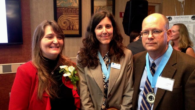Among the award winners Tuesday evening at the annual Law Day Celebration were Twyla Sketchley, left, Stephanie Johnson and Circuit Judge Jonathan Sjostrom.