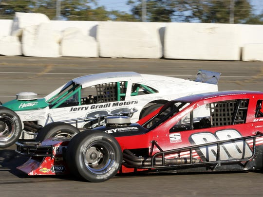 Matt Hirschman, in the red No. 60, battles with Chuck Hossfeld in Turn 3 during the Sunoco Race of Champions Modified 200 at Chemung Speedrome in October of 2015.