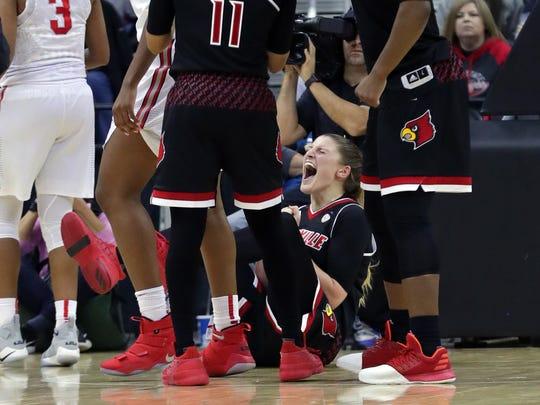 Louisville's Sam Fuehring celebrates after forcing