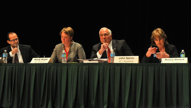 Wisconsin Assembly candidate debate involving Dave Heaton, left, Mandy Wright, John Spiros, and Nancy Stencil Wednesday night, Oct. 1, 2014, at the UW Center for Civic Engagement in Wausau.