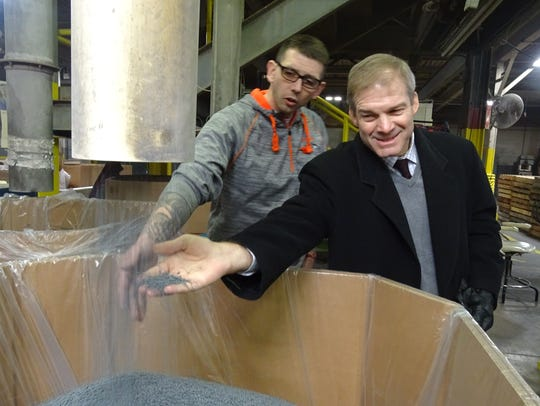 US Rep. Jim Jordan grabs a handful of PVC pellets at