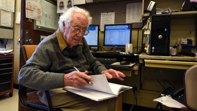 Oliver Smithies, the biologist whose gene-altering techniques revolutionized modern genetics, scours a notebook in this recent photo. Smithies, who died Tuesday after a short illness, was a member of the University of Wisconsin-Madison faculty from 1960 to 1988.