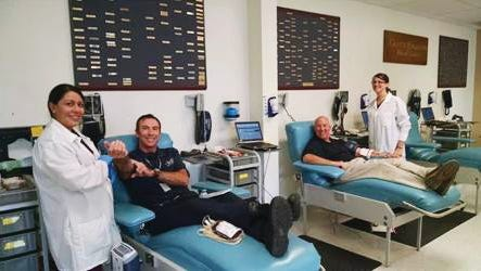 Participants give blood for the 2014 9/11 Blood Drive Challenge.