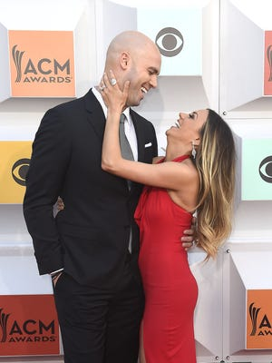 Jana Kramer and husband Mike Caussin on the red carpet at the 51st Academy of Country Music Awards.