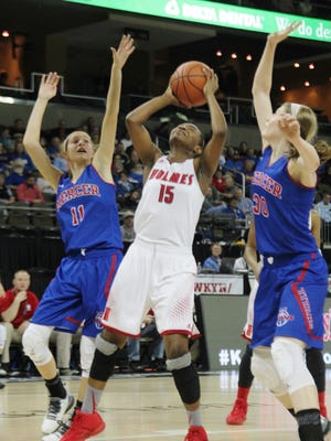 Holmes' Tyrah Englemon puts up a shot between Faith Lake, left and Emmy Souder, during the 2016 Sweet 16