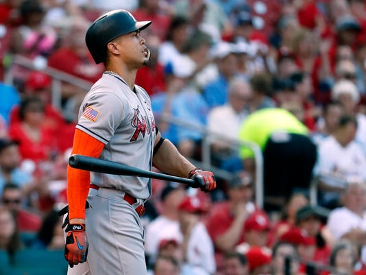 Miami Marlins' Giancarlo Stanton tosses his bat after striking out during the third inning of a baseball game against the St. Louis Cardinals Monday, July 3, 2017, in St. Louis. (AP Photo/Jeff Roberson)