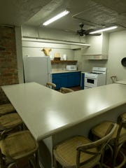 "The common kitchen area of the hostel at the Gardner Hotel after it was remodeled by ""Hotel Impossible."""