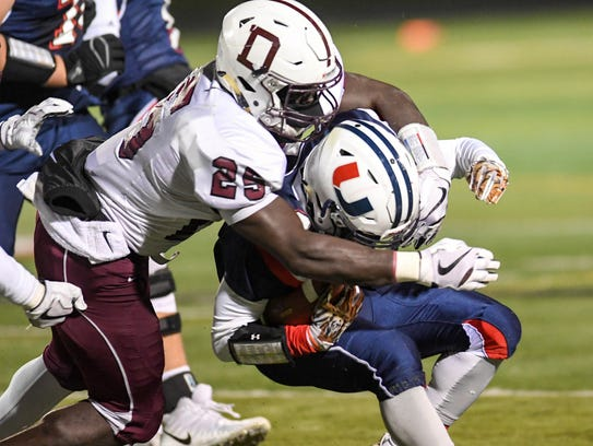 Urbandale's Henry Drake (2() gets tackled by Dowling's