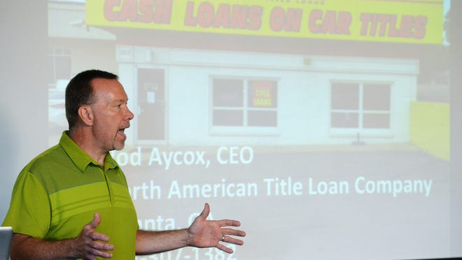 Steve Hildebrand, owner of Josiah's Coffeehouse & Caf? and a leader of a ballot initiative to cap the fees and interest rates on payday and title loans speaks during a press conference Tuesday, July 28, 2015.
